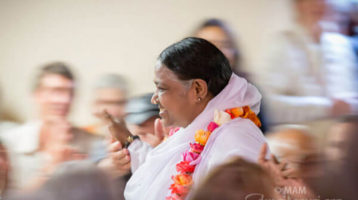 Amma giving darshan